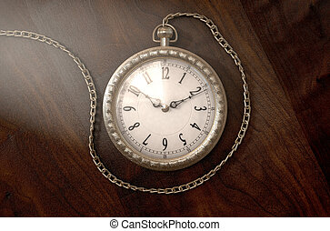 Pocket Watch On Chain - A closeup of an intricate gold...
