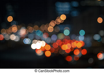 Colorful lights from cars in defocus, night, outdoor -...