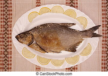 Fish bream baked in oven with lemon