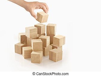 Single hand playing wooden box on isolated background.