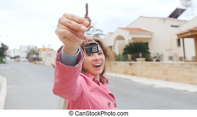 Happy apartment owner or renter showing keys and looking at...