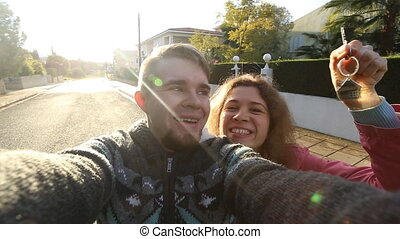 Happy Couple With Keys Standing Outside Home - Couple With...