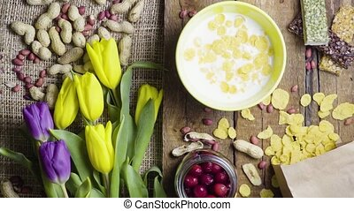 Breakfast flakes with tulips, rustic style - Breakfast corn...