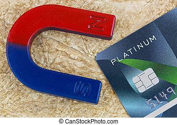 Magnet pulling platinum credit card on fiber paper...