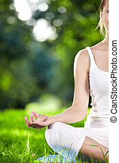 Yoga - Attractive girl in one of the yoga postures close up