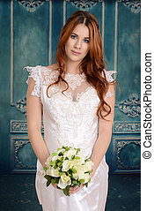 red head bride with bouquet - portrait of red head bride...