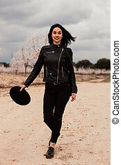 Brunette woman with leather jacket