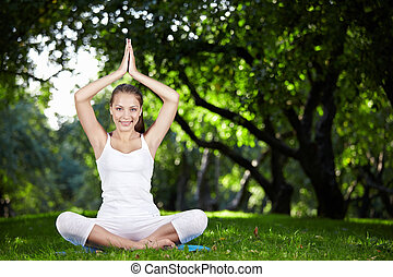 Healthy lifestyle - An attractive girl in a pose of yoga...