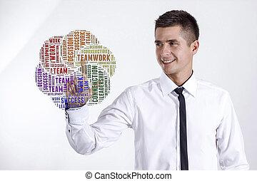 Teamwork - Young businessman touching word cloud
