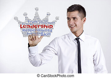 Leadership - Young businessman touching word cloud