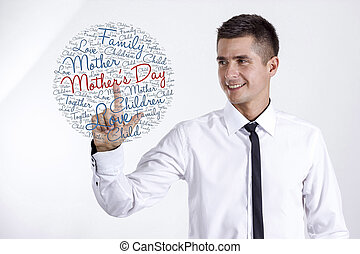 Mother's Day - Young businessman touching word cloud