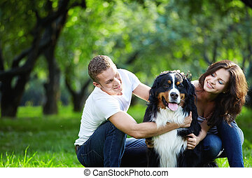 Happy moments - Portrait of a young couple with a dog