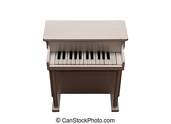 musical instrument white piano top view on a white...
