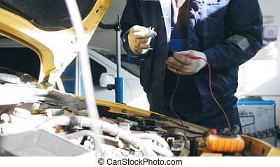 Mechanic in auto service - repairing electricity compartment...