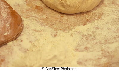 Woman working with dough. making homemade croissants - The...
