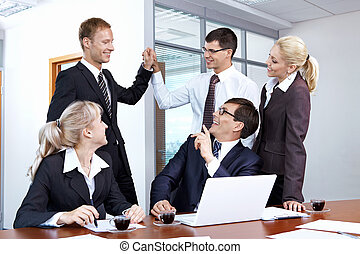 Success - Young businessmen rejoice in the success of the...