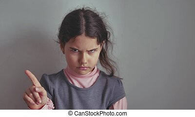 Teen girl shaking her head no finger gesture gesture is not...