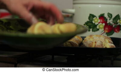 Freshly baked croissants on a plate in a home kitchen -...