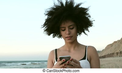 Emotional reaction while using phone - Model with mixed race...