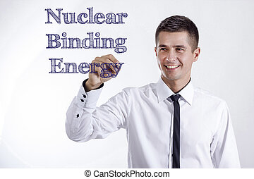 Nuclear Binding Energy - Young smiling businessman writing...