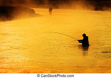 Silhouette of Man Flyfishing in River - Silhouette of Man...