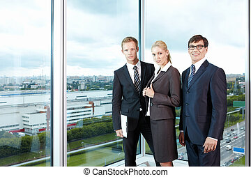 Team members - With employees in suits against the big...