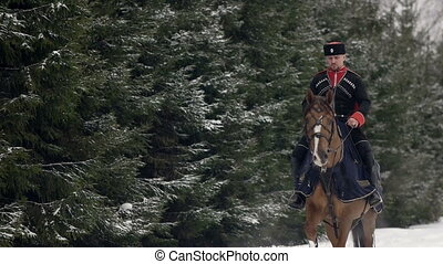 Men horseback riding a big brown horse in beautiful snowy...