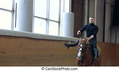 A man riding trick and Vaulting on horse. A man riding a...