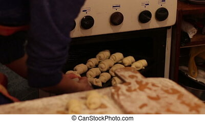 Just molded homemade croissants dough are placed in the oven kitchen stove