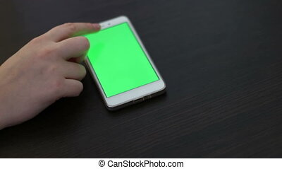 Touch Screen On White Smartphone Green Screen.Using...