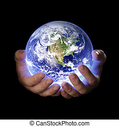 Our planet - Man holding a glowing earth globe in his hands....