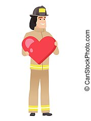 Caucasian firefighter holding a big red heart.