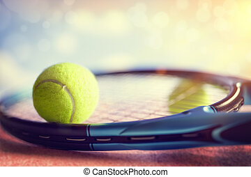 Tennis racket and ball - Tennis ball resting on top of a...