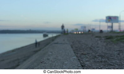 Girl on an evening jog. Young woman running in the city on...