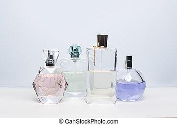 Different perfume bottles on white background. Perfumery, cosmetics.