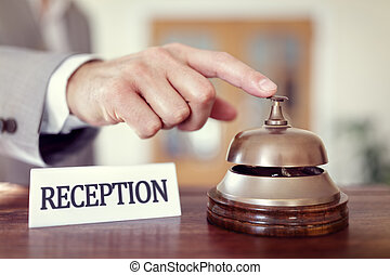 Hotel reception service bell - Businessman ringing a hotel...