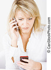 blonde with two mobile phones - surprised blonde with two...