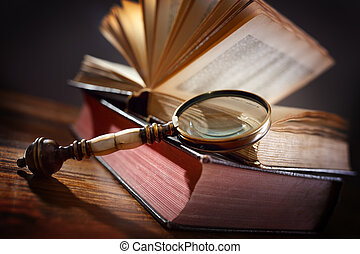 Old book and magnifying glass - Book and magnifying glass...