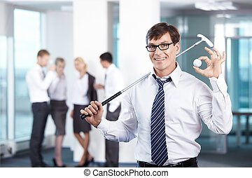Rest - Businessman with a golf club against the staff office