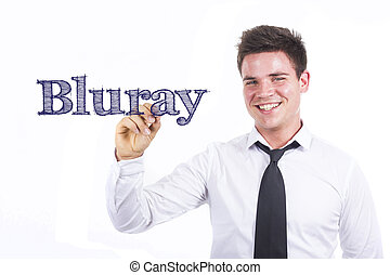 Bluray - Young smiling businessman writing on transparent...