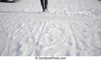 Close-up legs walking in street outdoors in snowy Russian winter
