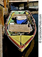 Old colorful wooden row boat at a dock - An old colorful...