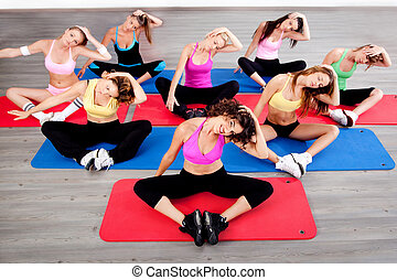 women doing floor excercise - image of women doing floor...