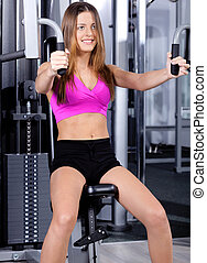 lady doing chest press