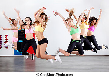 ladies in aerobic class - group of ladies working out in...