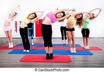 female stretching in an aerobics exercise class