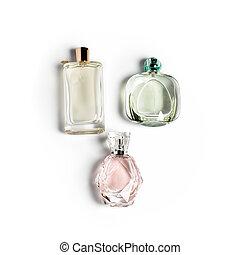 Perfume bottles on light background. Perfumery, cosmetics, fragrance collection.