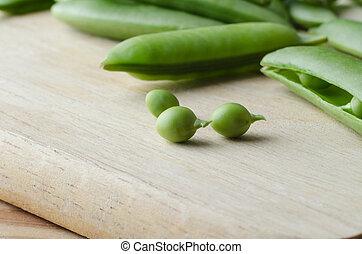 Green Peas and Pods on Wooden Chopping Board - Food...