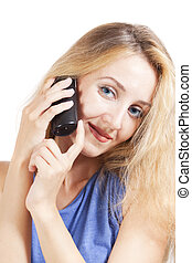young blond woman talking by phone on  white background