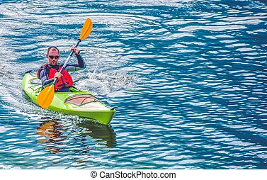 Kayak Lake Tour. Caucasian Men Paddling in the Kayak on the...